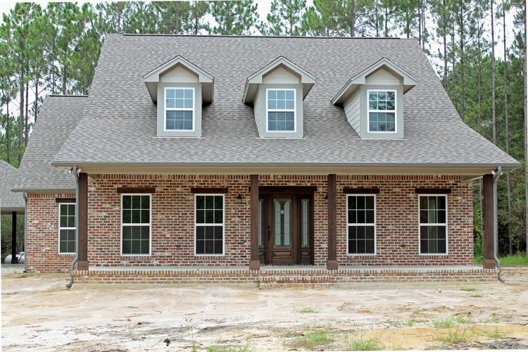 Custom home builders houston legal eagle contractors for Custom brick homes