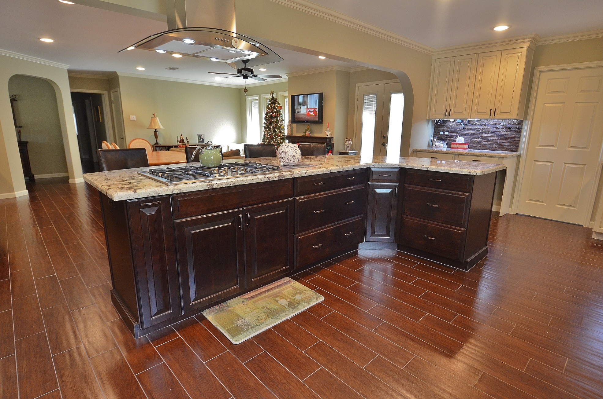 Braes meadow whole house renovation legal eagle contractors the wood floor is expansive and gorgeous it is actually wood look tile the perfect surface for a large kitchen with two busy cooks dailygadgetfo Images