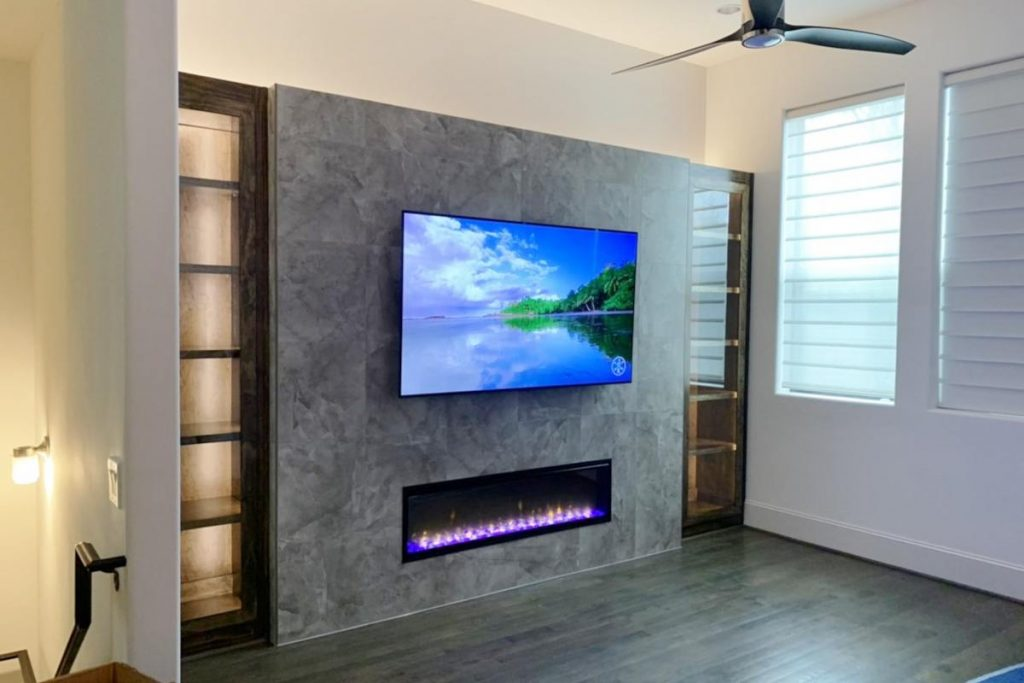 Banks - entertainment center, faux wood plank flooring and 3-blade fan
