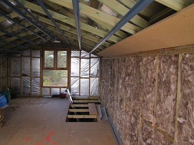 Wall insulation in unfinished attic conversion