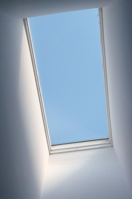 Skylight with view of blue sky from attic conversion