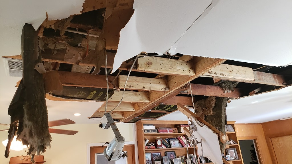 Burst water pipe and ceiling damage in kitchen
