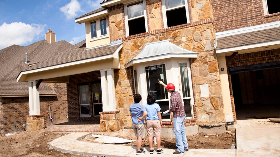 Homeowners introduced to new home by builder
