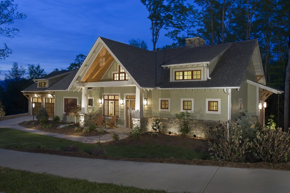 Custom built home at night with interior lights on