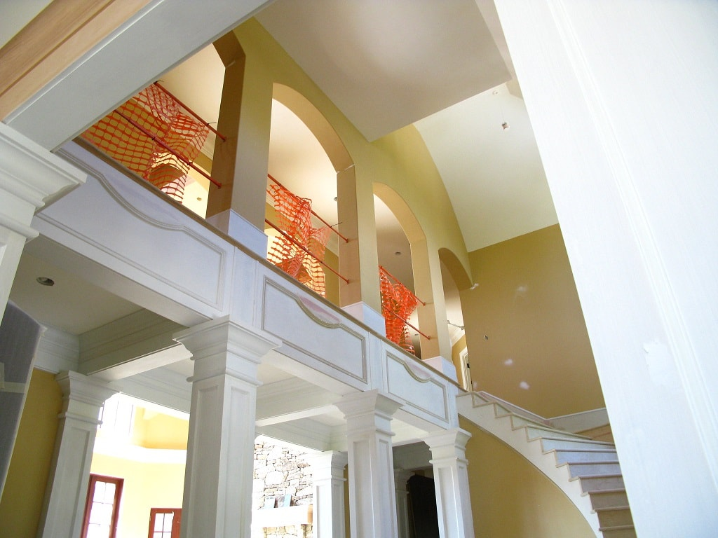 Staircase and arches in custom built home