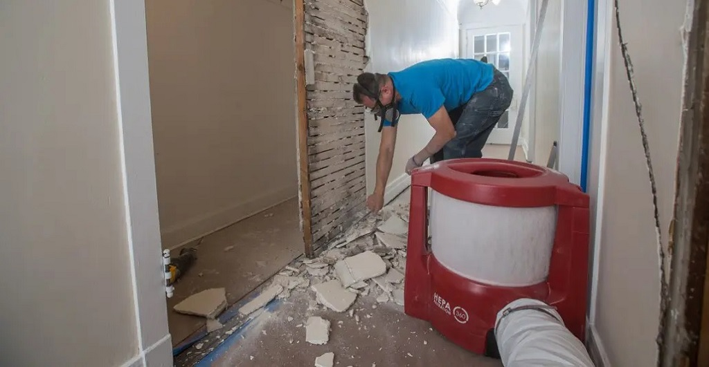 Clearing dust from a home rmeodel with a dust contorl machine